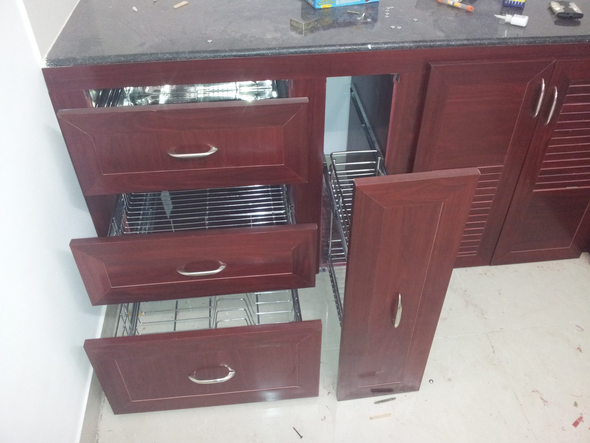 Pvc modular kitchen coimbatore redme interiors for Modular kitchen cupboard